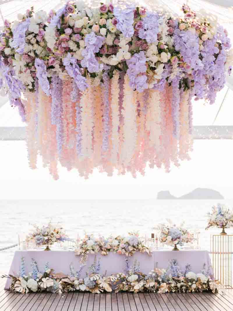"Our Bride wanted to ""wow"" her guests with her dinner reception, we think this grand floral chandelier did the trick! #woweffect"