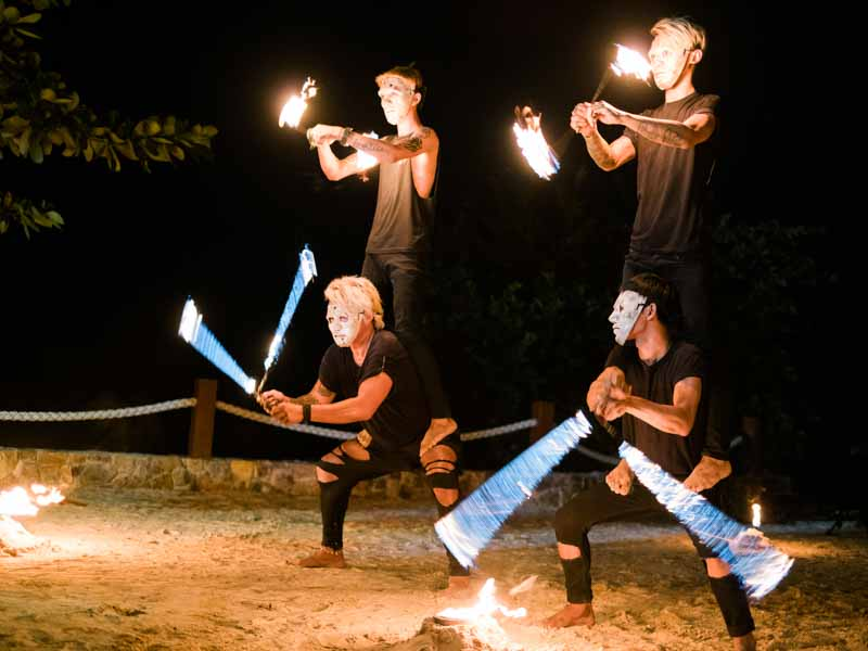 Find interesting entertainment that's native to your venue's location. Fire dance shows were a specialty to Thailand, the location of our Bride and Groom's wedding…so we thought, why not hire them as the entertainment? #crowdwentwild
