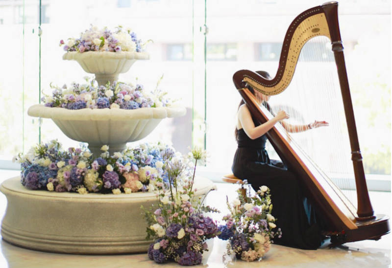 Our Bride wanted something elegant, sophisticated, and graceful…so we though, how about a fountain full of florals paired with a lovely harp to entertain guests during cocktail hour? #weddingthemewin