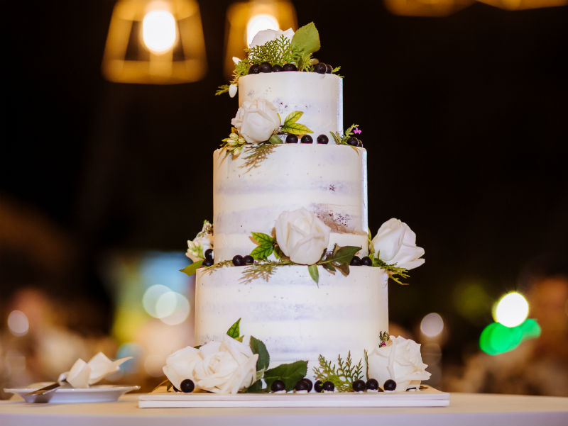 A naked cake with wild blueberries and fresh florals, said the Bride and Groom. We came up with this design and our cake partner executed it perfectly! #weddingcakeinspo