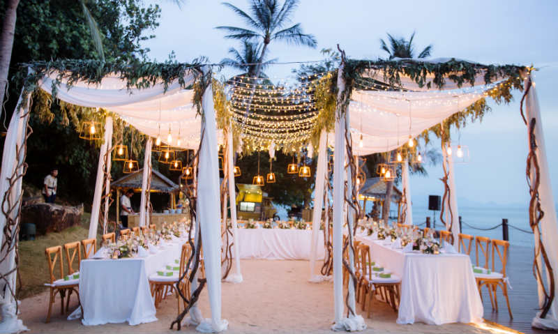 Something that blended in with the natural greenery. Rustic, fairy lights, and very dreamy. #weddingbythebeach